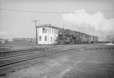 2016.020.98.128--jim neubauer 828 neg--NYC--steam locomotive on passenger train at 16th Street interlocking tower--Chicago IL--1953 0223