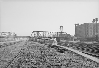 2016.020.98.130--jim neubauer 828 neg--MONON--EMD diesel locomotive on passenger train on C&WI tracks at 18th St Yard--Chicago IL--c1951 0000