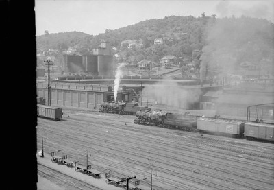 2016.020.98.189--jim neubauer 828 neg--N&W--steam locomotive switching in yard scene--Bluefield WV--no date