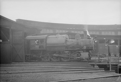 2016.020.98.186--jim neubauer 828 neg--N&W--steam locomotive 0-8-0T W5 821 at roundhouse--location unknown--no date