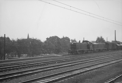 2016.020.98.134--jim neubauer 828 neg--ICRR--EMD diesel cow-calf switcher with freight transfer train at 111th Street (Pullman)--Chicago IL--1952 0803