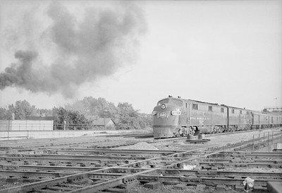 2016.020.98.120--jim neubauer 828 neg--GM&O--EMD diesel locomotive on passenger train northbound--Joliet IL--c1952 0000