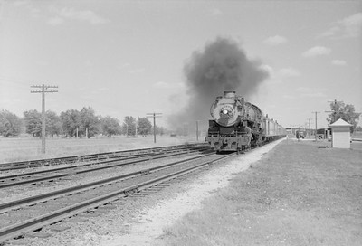 2016.020.98.041--jim neubauer 828 neg--UP--steam locomotive 7035 on passenger train 69 action--Funston KS--c1953 0700