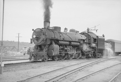 2016.020.98.044--jim neubauer 828 neg--UP--steam locomotive 4-6-2 2889 taking water--KS--c1953 0000
