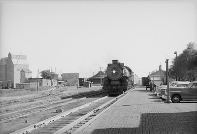 2016.020.98.052--jim neubauer 828 neg--UP--steam locomotive 7035 on passenger train 70 at station--Jct City KS--c1953 0000
