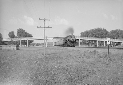 2016.020.98.042--jim neubauer 828 neg--UP--steam locomotive on eastbound morning passenger train action--Camp Funston KS--c1953 0000