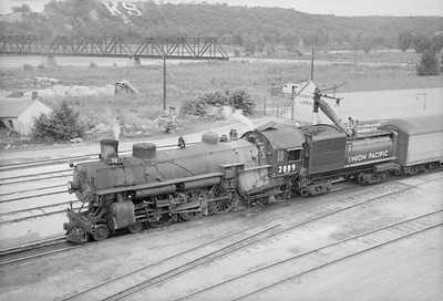 2016.020.98.043--jim neubauer 828 neg--UP--steam locomotive 4-6-2 2889 taking water--KS--c1953 0000