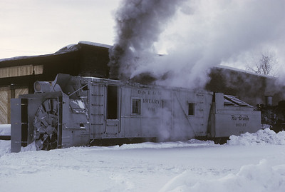 2016.020.51.06--neubauer 35mm kodachrome--C&TS--rotary snowplow OM fantrip preparation--Chama NM--1975 0200