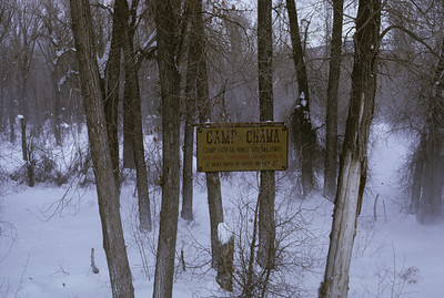 2016.020.51.16--neubauer 35mm kodachrome--C&TS--rotary snowplow OM fantrip Camp Chama sign seen from train--Chama NM--1975 0200