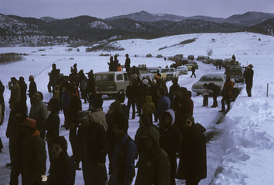 2016.020.51.25--neubauer 35mm kodachrome--C&TS--rotary snowplow OM fantrip chase crowd at Highway 17--near Chama NM--1975 0200