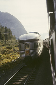 2016.020.08.14--jim neubauer 35mm kodachrome--CP--The Canadian meets The Mountaineer passenger train in the Rockies--location unknown--1958 0900
