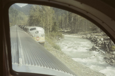 2016.020.08.10--jim neubauer 35mm kodachrome--CP--view from The Mountaineer passenger train of passing freight in the Rockies--location unknown--1958 0900