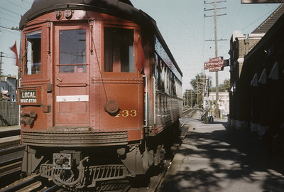 2016.020.13.1955-2--neubauer 35mm kodachrome--CA&E--electric interurban 433 making station stop at depot--Wheaton IL--1955 0911