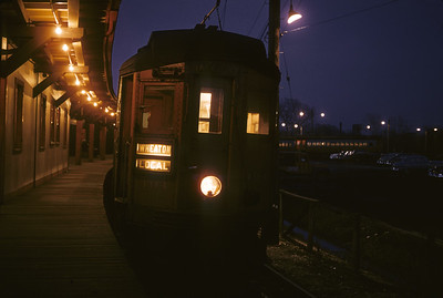 2016.020.13.1957-15--neubauer 35mm kodachrome--CA&E--electric interurban 404 at station platform at night--Forest Park IL--1957 0424