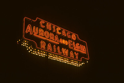 2016.020.13.1957-13--neubauer 35mm kodachrome--CA&E--neon sign at night--Forest Park IL--1957 0424