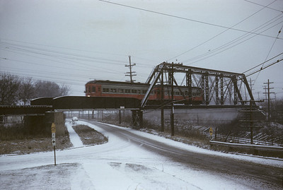 2016.020.13.1958-21--neubauer 35mm kodachrome--CA&E--electric interurban 320 and 319 last fantrip crossing over C&NW and Wesley Street--Wheaton IL--1958 1207