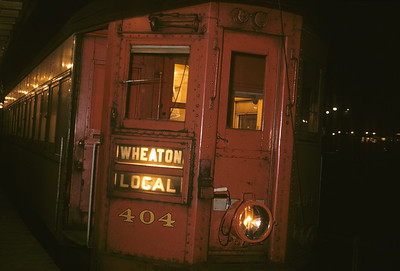 2016.020.13.1957-17--neubauer 35mm kodachrome--CA&E--electric interurban 404 at station platform at night--Forest Park IL--1957 0424