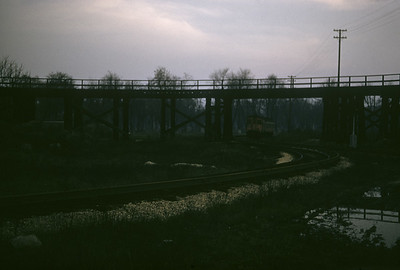 2016.020.13.1957-05--neubauer 35mm kodachrome--CA&E--CTA elevated track crossing over CA&E track--Forest Park IL--1957 0424