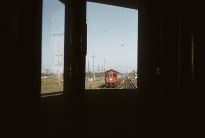 2016.020.13.1955-4--neubauer 35mm kodachrome--CA&E--view from electric interurban train at passing interurban--near Wheaton IL--1955 0911