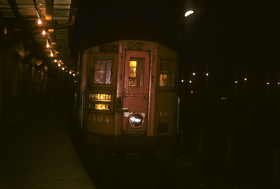 2016.020.13.1957-14--neubauer 35mm kodachrome--CA&E--electric interurban 404 at station platform at night--Forest Park IL--1957 0424