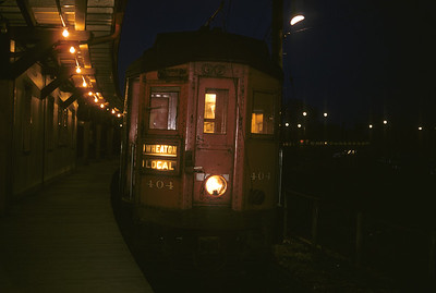 2016.020.13.1957-16--neubauer 35mm kodachrome--CA&E--electric interurban 404 at station platform at night--Forest Park IL--1957 0424