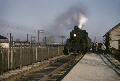 2016.020.01.1955-028--jim neubauer 35mm kodachrome--C&NW--steam locomotive 4-6-2 E 555 on commuter passenger train station stop at depot--Avondale IL--1955 0400