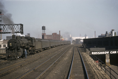 2016.020.01.1955-026--jim neubauer 35mm kodachrome--C&NW--steam locomotive 4-6-2 E 558 on commuetr passenger train seen from another train--Chicago IL--1955 0400