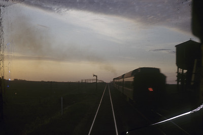 2016.020.01.1952-022--jim neubauer 35mm kodachrome--C&NW--Clinton local passenger train seen from eastbound train 14--Malta IL--1952 0530
