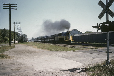 2016.020.01.1955-039--jim neubauer 35mm kodachrome--C&NW--steam locomotive 4-6-2 E-S 620 (streamlined) with passenger train 509 action--Palatine IL--1955 0800