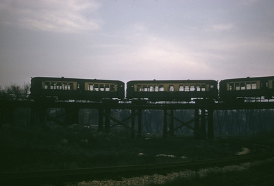 2016.020.14.1951-1--neubauer 35mm kodachrome--CTA--electric elevated train crossing over C&AE track--Forest Park IL--1951 0424