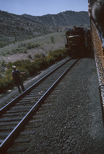 2016.020.26.24--jim neubauer 35mm kodachrome--D&RGW--view of EMD diesel locomotive meeting passenger train from vestibule--location unknown--1963 0900