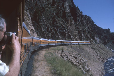 2016.020.26.19--jim neubauer 35mm kodachrome--D&RGW--view of passenger train from vestibule--location unknown--1963 0900