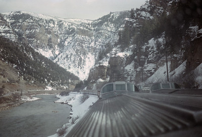 2016.020.26.09--jim neubauer 35mm ektachrome--D&RGW--view from dome car on passenger train passing another train--location unknown--1955 0000