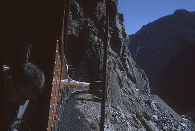 2016.020.26.21--jim neubauer 35mm kodachrome--D&RGW--view from passenger train vestibule--location unknown--1963 0900