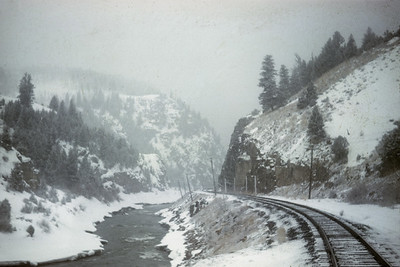 2016.020.26.11--jim neubauer 35mm kodachrome--D&RGW--view from passenger train of snow--location unknown--1958 0400