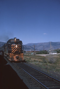 2016.020.26.16--jim neubauer 35mm kodachrome--D&RGW--EMD diesel locomotive 3028 as seen from passenger train--location unknown--1963 0900