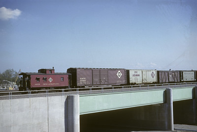 2016.020.18.04--jim neubauer 35mm kodachrome--EL--caboose on hind end of freight train at 95th Street--Chicago IL--1962 1000