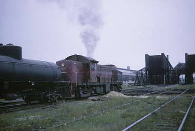 2016.020.05.05--jim neubauer 35mm kodachrome--GM&O--ALCO diesel locomotive 1107 with transfer freight train at Ash Street interlocking action--Chicago IL--1964 1000