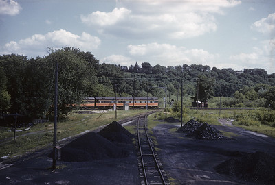 2016.020.04.02--jim neubauer 35mm kodachrome--ICRR--hind end of passenger train clearing diamond--location unknown--1961 0700