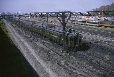 2016.020.04.08--jim neubauer 35mm kodachrome--ICRR--electric commuter MU passenger train passing fair--Chicago IL--1963 0700