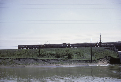 2016.020.04.09--jim neubauer 35mm kodachrome--ICRR--electric commuter MU passenger train crossing high fill and bridge--Riverdale--IL--1964 0500