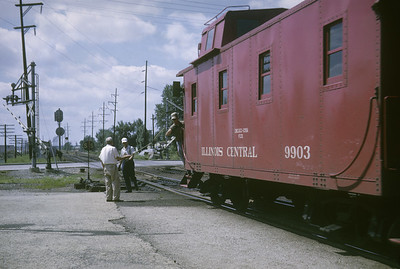 2016.020.04.05--jim neubauer 35mm kodachrome--ICRR--caboose 9903 on hind end of freight train hooping up orders action--Broadview IL--1963 0727
