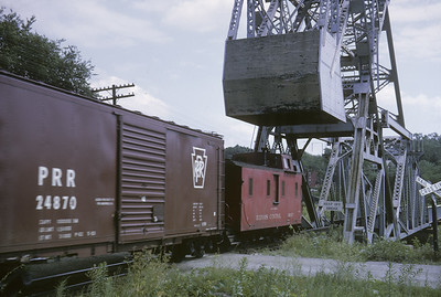 2016.020.04.07--jim neubauer 35mm kodachrome--ICRR--caboose on hind end of freight train crossing Bascule lift bridge--location unknown--1963 0800