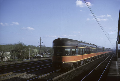 2016.020.04.10--jim neubauer 35mm kodachrome--ICRR--obs passenger car on hind end of Panama Ltd at 51st Street--Chicago IL--1964 0500