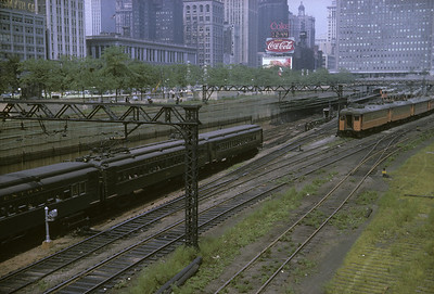 2016.020.04.03--jim neubauer 35mm kodachrome--ICRR--scene of electric commuter MU passenger train meeting CSS&SB train at Randolph Street yard--Chicago IL--1962 0900
