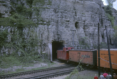 2016.020.04.01--jim neubauer 35mm kodachrome--ICRR--caboose on hind end of freight train exiting tunnel crossing CB&Q--East Dubuque IA--1961 0500