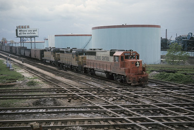 2016.020.04.27--jim neubauer 35mm ektachrome--ICRR--EMD diesel locomotive 3045 on freight train from Iowa crossing diamond at Ash Street heading to Markham yard--Chicago IL--1969 0500
