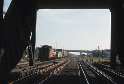 2016.020.04.21--jim neubauer 35mm ektachrome--ICRR--freight transfer train exiting Chicago River bridge at Ash Street interlocking--Chicago IL--1968 1000