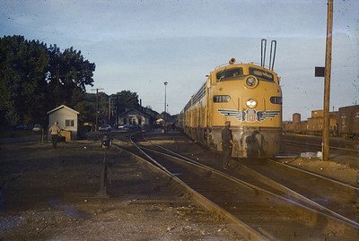 2016.020.02.1957-2--neubauer 35mm kodachrome--CMStP&P--EMD diesel locomotive on passenger train--location unknown--1957 0000