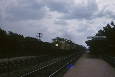 2016.020.02.1958-1--neubauer 35mm kodachrome--CMStP&P--EMD diesel locomotive on passenger train action--Forest Glen IL--1958 0600